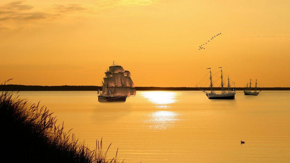 Bilde av seilskuter i solnedgang